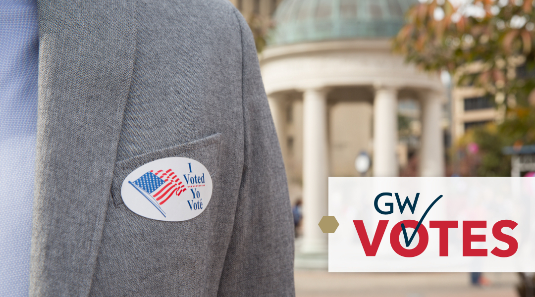 GW Votes logo over picture of student displaying voting sticker in Kogan Plaza
