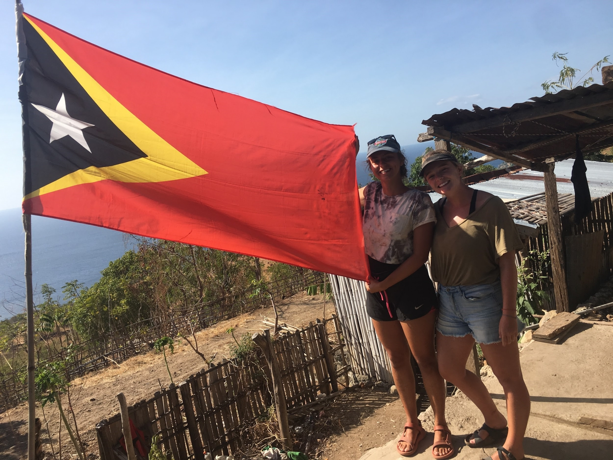 Flag of timor-leste, with two gw students