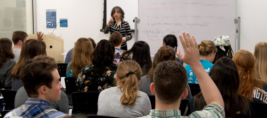 amy talking to a group of students