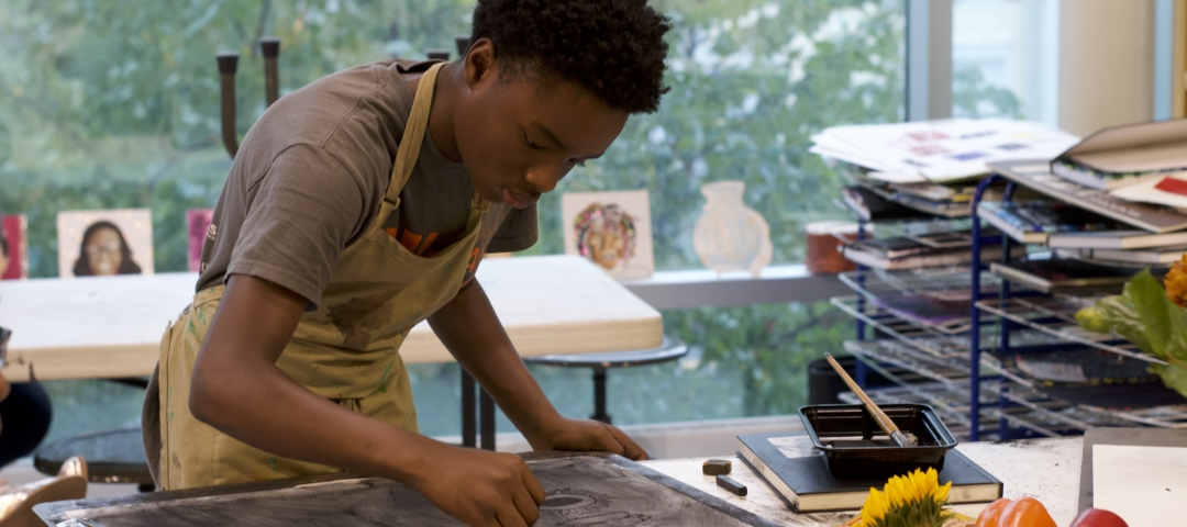 young man working on his artwork